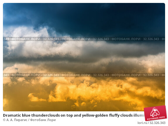 Купить «Dramatic blue thunderclouds on top and yellow-golden fluffy clouds illuminated by rays of sun on below. Stunning view natural meteorology background. Amazing cloudscape to weather change before rain.», фото № 32326343, снято 1 сентября 2019 г. (c) А. А. Пирагис / Фотобанк Лори