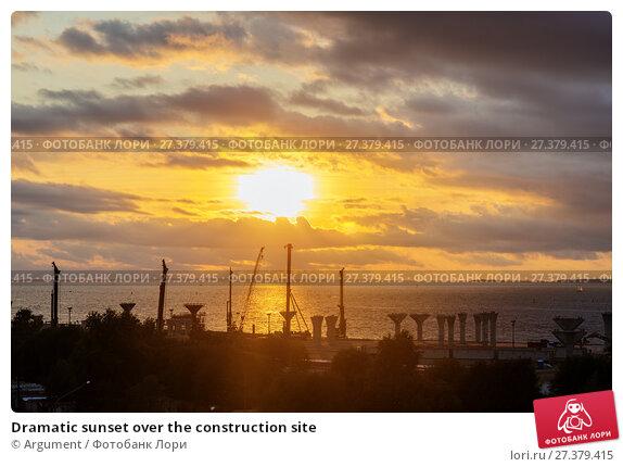 Купить «Dramatic sunset over the construction site», фото № 27379415, снято 3 сентября 2014 г. (c) Argument / Фотобанк Лори