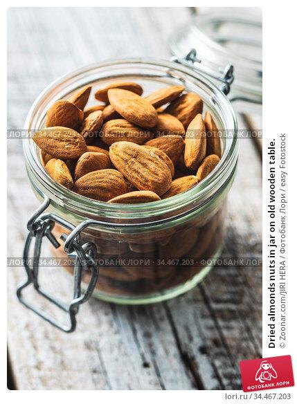Dried almonds nuts in jar on old wooden table. Стоковое фото, фотограф Zoonar.com/JIRI HERA / easy Fotostock / Фотобанк Лори