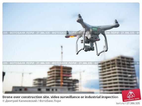 Купить «Drone over construction site. video surveillance or industrial inspection», фото № 27386335, снято 26 июля 2017 г. (c) Дмитрий Калиновский / Фотобанк Лори