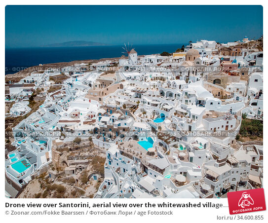 Drone view over Santorini, aerial view over the whitewashed village... Стоковое фото, фотограф Zoonar.com/Fokke Baarssen / age Fotostock / Фотобанк Лори