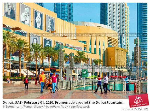 Dubai, UAE - February 01, 2020: Promenade around the Dubai Fountain... Стоковое фото, фотограф Zoonar.com/Roman Sigaev / age Fotostock / Фотобанк Лори