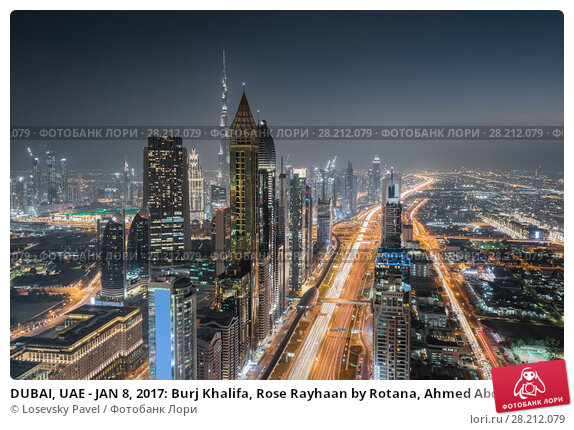 Купить «DUBAI, UAE - JAN 8, 2017: Burj Khalifa, Rose Rayhaan by Rotana, Ahmed Abdul Rahim Al Attar Tower at night, Sheikh Zayed highway», фото № 28212079, снято 8 января 2017 г. (c) Losevsky Pavel / Фотобанк Лори