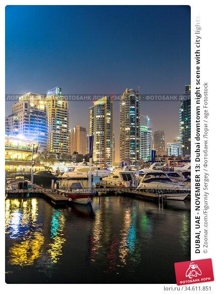 DUBAI, UAE - NOVEMBER 13: Dubai downtown night scene with city lights... Стоковое фото, фотограф Zoonar.com/Figurniy Sergey / age Fotostock / Фотобанк Лори