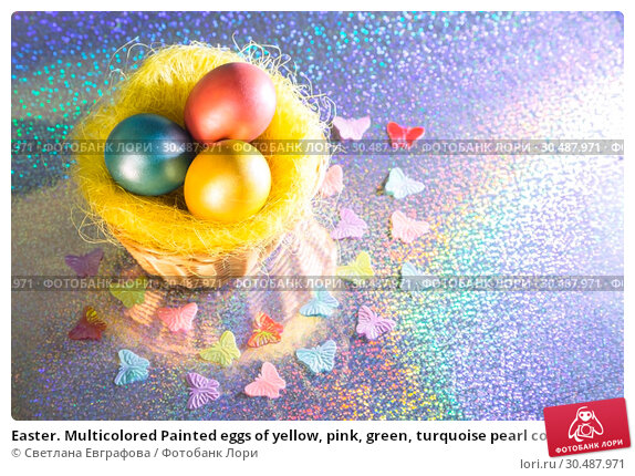 Купить «Easter. Multicolored Painted eggs of yellow, pink, green, turquoise pearl color in a basket on a holographic rainbow background with a copy space», фото № 30487971, снято 31 марта 2019 г. (c) Светлана Евграфова / Фотобанк Лори