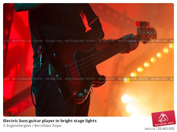 Купить «Electric bass guitar player in bright stage lights», фото № 29465935, снято 11 декабря 2016 г. (c) EugeneSergeev / Фотобанк Лори