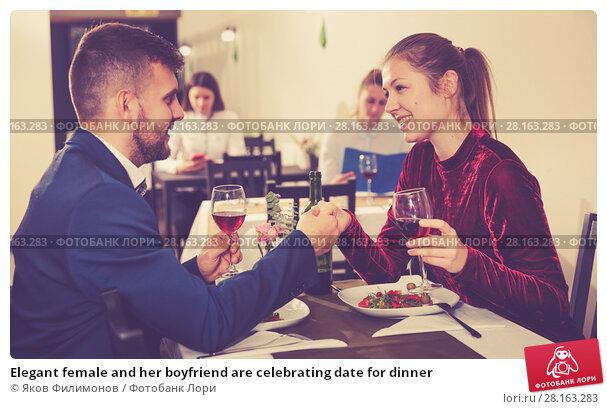 Купить «Elegant female and her boyfriend are celebrating date for dinner», фото № 28163283, снято 18 декабря 2017 г. (c) Яков Филимонов / Фотобанк Лори