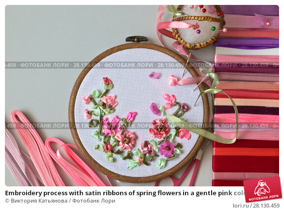 Купить «Embroidery process with satin ribbons of spring flowers in a gentle pink color», фото № 28130459, снято 27 февраля 2018 г. (c) Виктория Катьянова / Фотобанк Лори