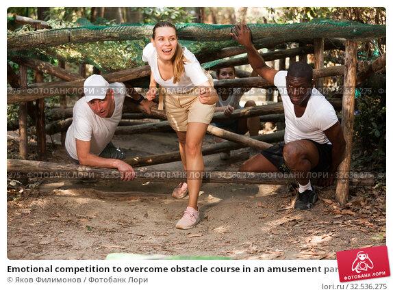 Купить «Emotional competition to overcome obstacle course in an amusement park», фото № 32536275, снято 9 июля 2020 г. (c) Яков Филимонов / Фотобанк Лори