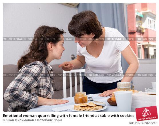 Купить «Emotional woman quarrelling with female friend at table with cookies», фото № 30968599, снято 18 июля 2019 г. (c) Яков Филимонов / Фотобанк Лори