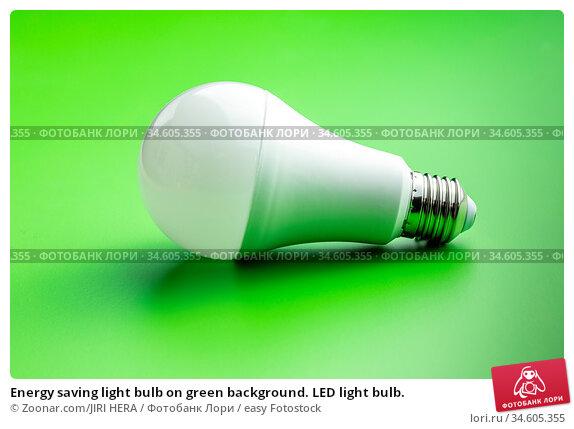 Energy saving light bulb on green background. LED light bulb. Стоковое фото, фотограф Zoonar.com/JIRI HERA / easy Fotostock / Фотобанк Лори