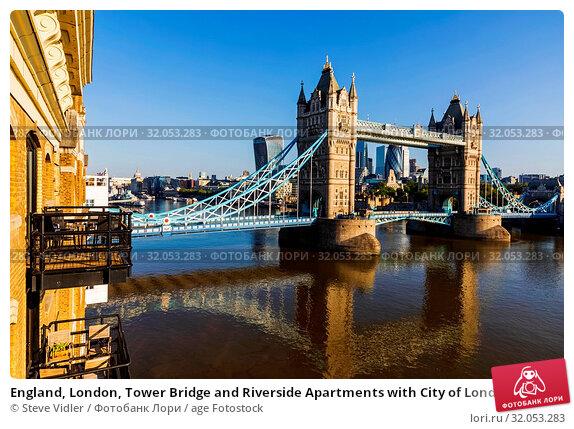 England, London, Tower Bridge and Riverside Apartments with City of London Skyline. Стоковое фото, фотограф Steve Vidler / age Fotostock / Фотобанк Лори