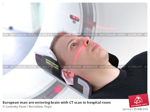 Купить «European man are entering brain with CT scan in hospital room», фото № 25840015, снято 31 августа 2015 г. (c) Losevsky Pavel / Фотобанк Лори