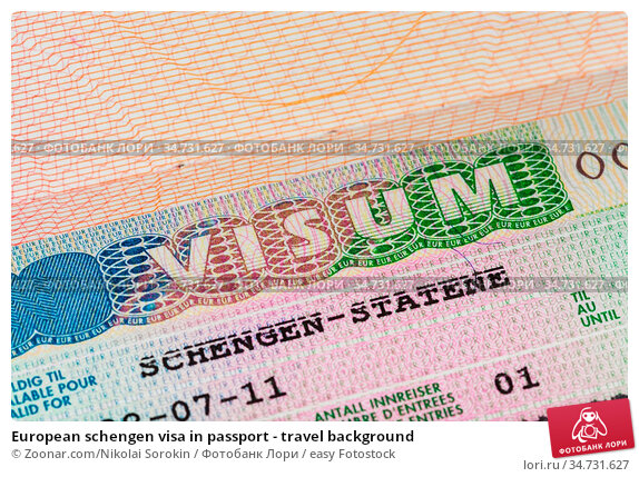 European schengen visa in passport - travel background. Стоковое фото, фотограф Zoonar.com/Nikolai Sorokin / easy Fotostock / Фотобанк Лори