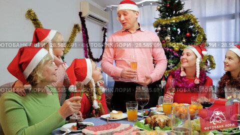 Купить «Family is talking toasts and drinking in time celebration New Year at home.», видеоролик № 28585691, снято 17 января 2018 г. (c) Яков Филимонов / Фотобанк Лори