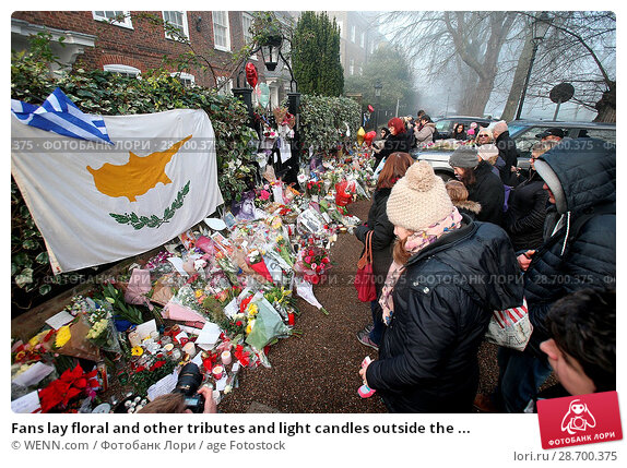 Купить «Fans lay floral and other tributes and light candles outside the home of singer George Michael in memory of the popular performer. His Range Rover has...», фото № 28700375, снято 28 декабря 2016 г. (c) age Fotostock / Фотобанк Лори