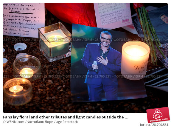 Купить «Fans lay floral and other tributes and light candles outside the home of singer George Michael in memory of the popular performer. His Range Rover has...», фото № 28700531, снято 28 декабря 2016 г. (c) age Fotostock / Фотобанк Лори