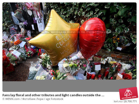 Купить «Fans lay floral and other tributes and light candles outside the home of singer George Michael in memory of the popular performer. His Range Rover has...», фото № 28700771, снято 28 декабря 2016 г. (c) age Fotostock / Фотобанк Лори