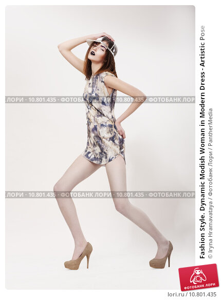 Fashion Style. Dynamic Modish Woman in Modern Dress - Artistic Pose, фото № 10801435, снято 29 мая 2017 г. (c) PantherMedia / Фотобанк Лори