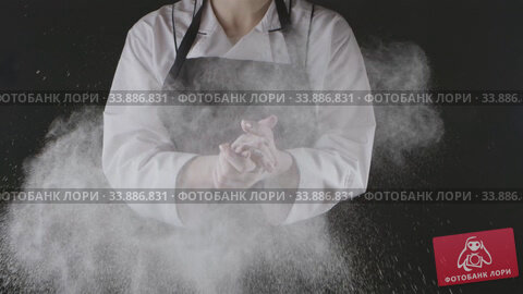 Купить «Female chef is clapping his hands filled with flour on a black background. Slow motion, Full HD video, 240fps, 1080p. Process preparing of homemade pastry.», видеоролик № 33886831, снято 13 июля 2020 г. (c) Ярослав Данильченко / Фотобанк Лори