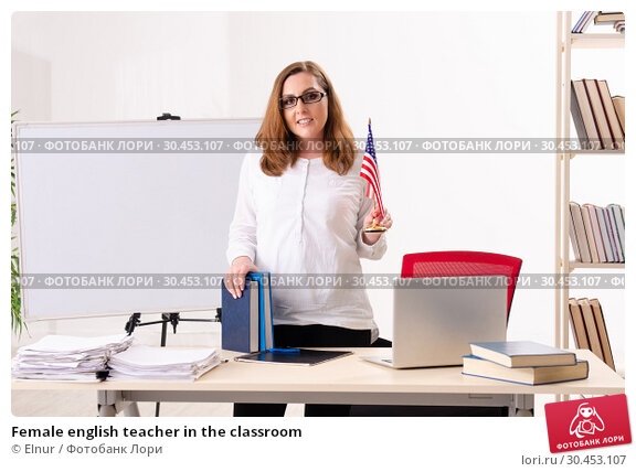 Female english teacher in the classroom. Стоковое фото, фотограф Elnur / Фотобанк Лори