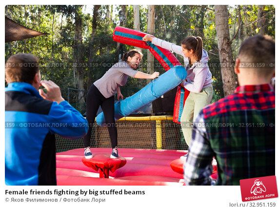 Female friends fighting by big stuffed beams. Стоковое фото, фотограф Яков Филимонов / Фотобанк Лори
