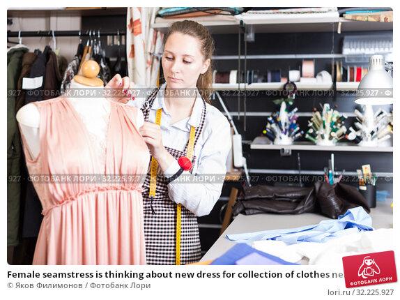 Купить «Female seamstress is thinking about new dress for collection of clothes near mannequin», фото № 32225927, снято 5 мая 2018 г. (c) Яков Филимонов / Фотобанк Лори