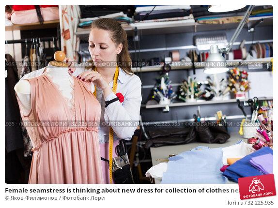 Купить «Female seamstress is thinking about new dress for collection of clothes near mannequin», фото № 32225935, снято 5 мая 2018 г. (c) Яков Филимонов / Фотобанк Лори
