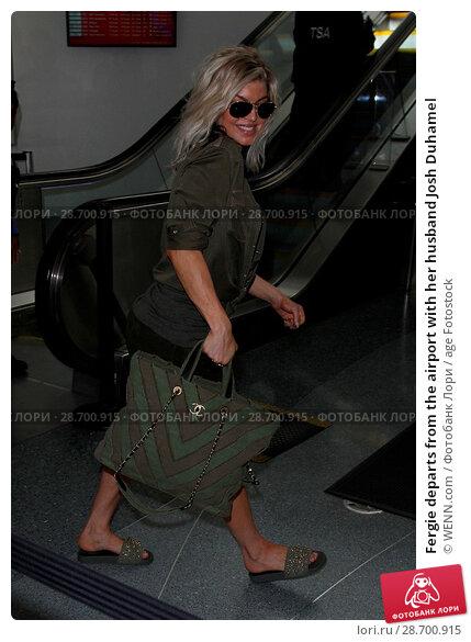 Купить «Fergie departs from the airport with her husband Josh Duhamel Featuring: Fergie, Josh Duhamel Where: Los Angeles, California, United States When: 29 Dec 2016 Credit: WENN.com», фото № 28700915, снято 29 декабря 2016 г. (c) age Fotostock / Фотобанк Лори