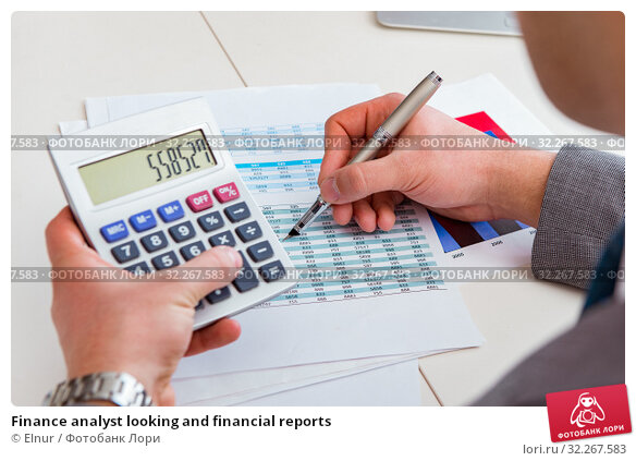 Finance analyst looking and financial reports. Стоковое фото, фотограф Elnur / Фотобанк Лори
