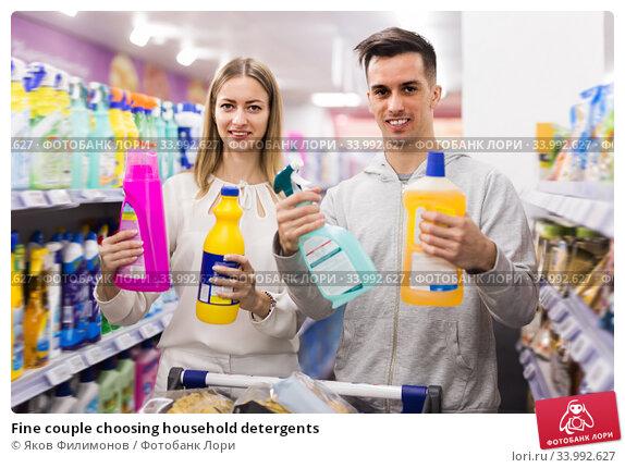 Fine couple choosing household detergents. Стоковое фото, фотограф Яков Филимонов / Фотобанк Лори