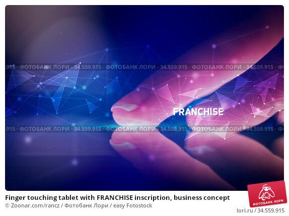 Finger touching tablet with FRANCHISE inscription, business concept. Стоковое фото, фотограф Zoonar.com/rancz / easy Fotostock / Фотобанк Лори