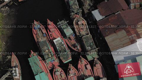 Купить «Fishing Boats parking on the river in Asia 4k Drone shot», видеоролик № 32391827, снято 4 ноября 2019 г. (c) Aleksejs Bergmanis / Фотобанк Лори