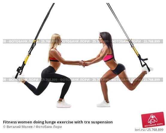 Fitness women doing lunge exercise with trx suspension, фото № 25768899, снято 28 января 2017 г. (c) Виталий Молев / Фотобанк Лори