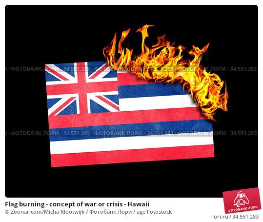 Flag burning - concept of war or crisis - Hawaii. Стоковое фото, фотограф Zoonar.com/Micha Klootwijk / age Fotostock / Фотобанк Лори