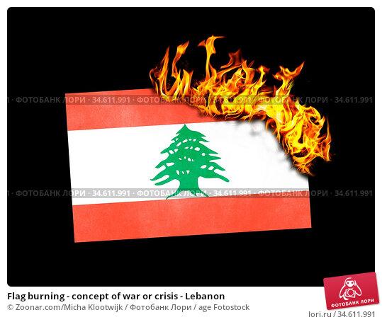 Flag burning - concept of war or crisis - Lebanon. Стоковое фото, фотограф Zoonar.com/Micha Klootwijk / age Fotostock / Фотобанк Лори