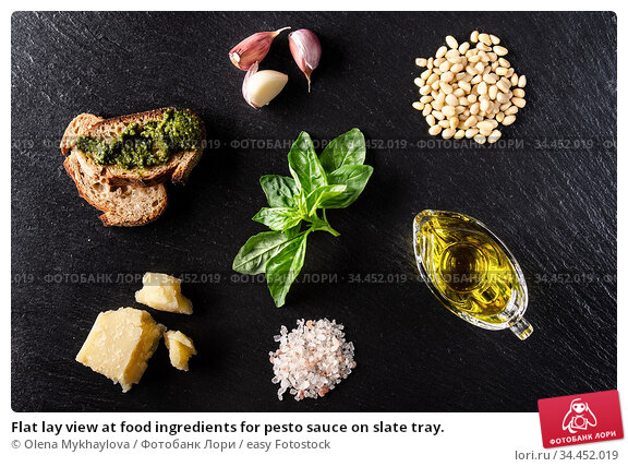Flat lay view at food ingredients for pesto sauce on slate tray. Стоковое фото, фотограф Olena Mykhaylova / easy Fotostock / Фотобанк Лори