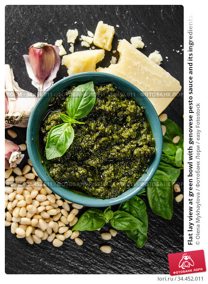 Flat lay view at green bowl with genovese pesto sauce and its ingredients... Стоковое фото, фотограф Olena Mykhaylova / easy Fotostock / Фотобанк Лори