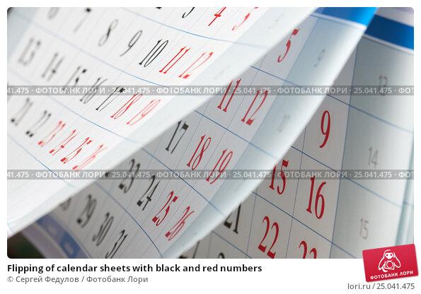 Купить «Flipping of calendar sheets with black and red numbers», фото № 25041475, снято 29 января 2017 г. (c) Сергей Федулов / Фотобанк Лори