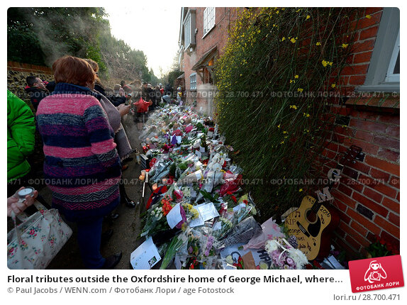 Купить «Floral tributes outside the Oxfordshire home of George Michael, where he was found dead on Christmas Day at Goring-on-Thames Featuring: Atmosphere Where...», фото № 28700471, снято 28 декабря 2016 г. (c) age Fotostock / Фотобанк Лори