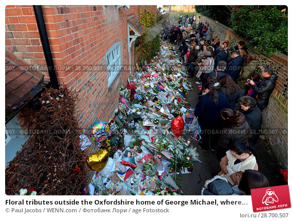 Купить «Floral tributes outside the Oxfordshire home of George Michael, where he was found dead on Christmas Day at Goring-on-Thames Featuring: Atmosphere Where...», фото № 28700507, снято 28 декабря 2016 г. (c) age Fotostock / Фотобанк Лори