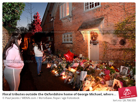 Купить «Floral tributes outside the Oxfordshire home of George Michael, where he was found dead on Christmas Day at Goring-on-Thames Featuring: Atmosphere Where...», фото № 28700555, снято 28 декабря 2016 г. (c) age Fotostock / Фотобанк Лори