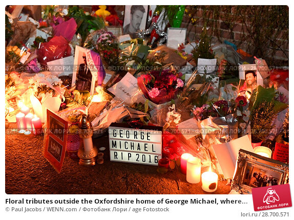 Купить «Floral tributes outside the Oxfordshire home of George Michael, where he was found dead on Christmas Day at Goring-on-Thames Featuring: Atmosphere Where...», фото № 28700571, снято 28 декабря 2016 г. (c) age Fotostock / Фотобанк Лори