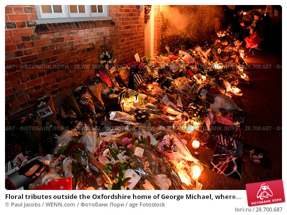 Купить «Floral tributes outside the Oxfordshire home of George Michael, where he was found dead on Christmas Day at Goring-on-Thames Featuring: Atmosphere Where...», фото № 28700687, снято 28 декабря 2016 г. (c) age Fotostock / Фотобанк Лори