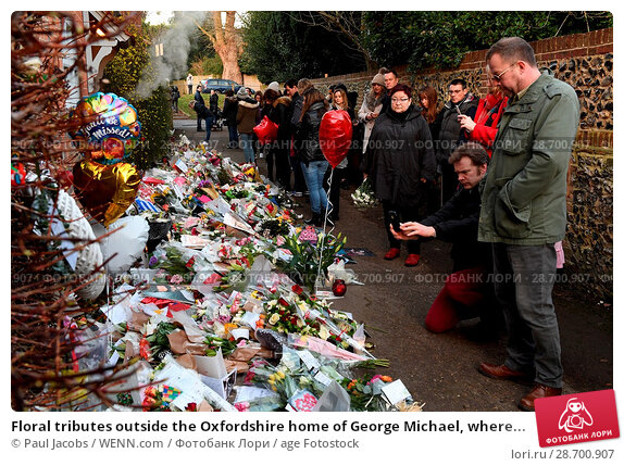 Купить «Floral tributes outside the Oxfordshire home of George Michael, where he was found dead on Christmas Day at Goring-on-Thames Featuring: Atmosphere Where...», фото № 28700907, снято 28 декабря 2016 г. (c) age Fotostock / Фотобанк Лори