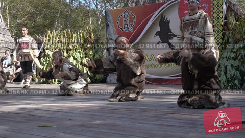 Folklore ensemble of indigenous people of Kamchatka dancing with tambourine in traditional clothing. Itelmens national ritual festival thanksgiving nature Alhalalalay. Kamchatka Peninsula (2019 год). Редакционное видео, видеограф А. А. Пирагис / Фотобанк Лори