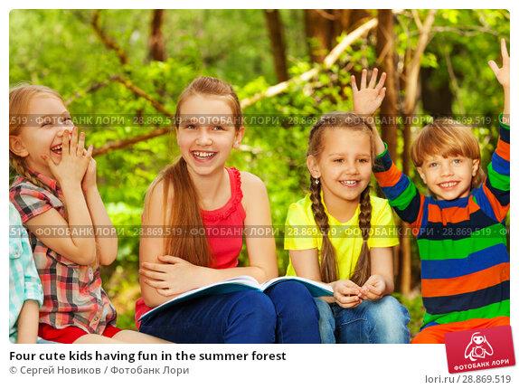 Купить «Four cute kids having fun in the summer forest», фото № 28869519, снято 9 мая 2016 г. (c) Сергей Новиков / Фотобанк Лори