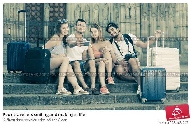 Купить «Four travellers smiling and making selfie», фото № 28163247, снято 22 июня 2017 г. (c) Яков Филимонов / Фотобанк Лори