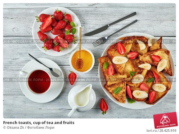 Купить «French toasts, cup of tea and fruits», фото № 28425919, снято 9 мая 2018 г. (c) Oksana Zh / Фотобанк Лори