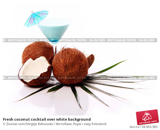 Fresh coconut cocktail over white background. Стоковое фото, фотограф Zoonar.com/Sergejs Rahunoks / easy Fotostock / Фотобанк Лори